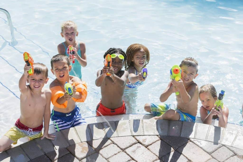 children playing with water guns